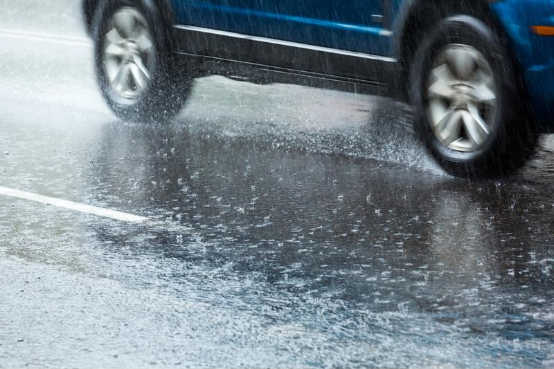 A hailstorm affects driving conditions on a highway.